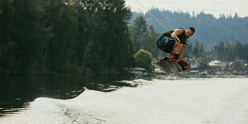Jumping the wake on a wakeboard.